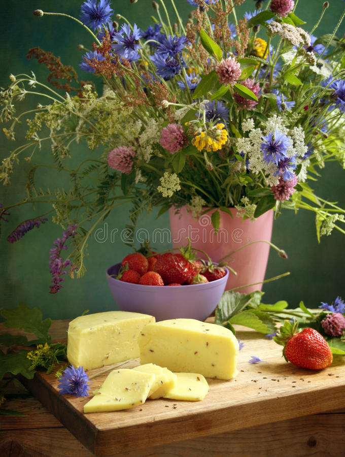 Solstice. Summer solstice still life with flowers and snacks royalty free stock photography