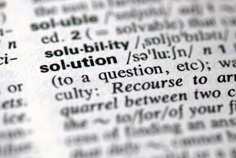A solução da palavra em um dicionário imagem de stock