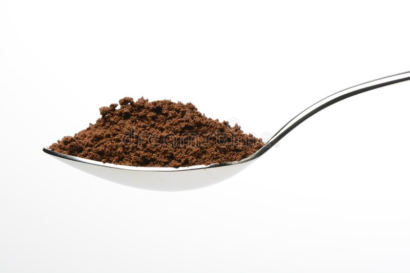 Soluble coffee in a spoon. On white background stock photography