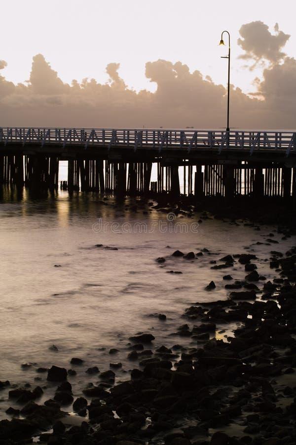 soluppgång för pirserieshorncliffe arkivfoton