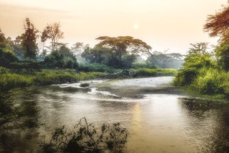 Soluppgång på den afrikanska floden