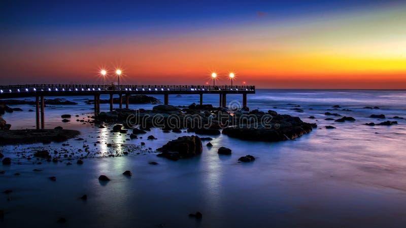 Soluppgång på den Homigot stranden arkivfoto