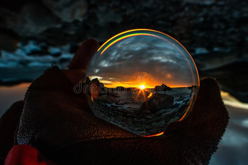 Soluppgång på Eftang, Larvik, Norge i kristallkula fotografering för bildbyråer