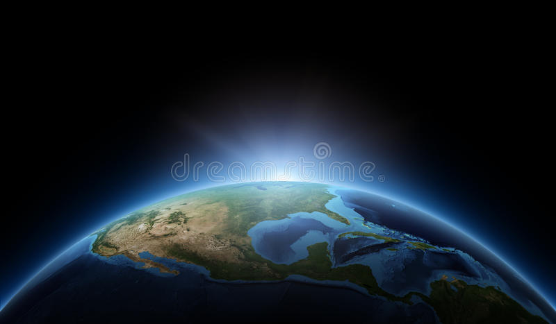 Soluppgång på jord arkivbilder