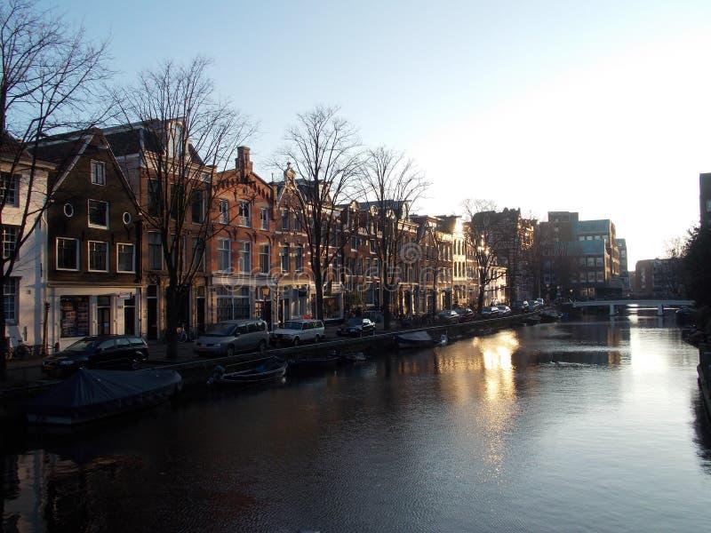 Soluppgången i Amsterdam fotografering för bildbyråer