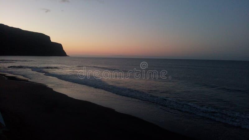 Soluppgångformosa strand azores Santa Maria royaltyfria bilder