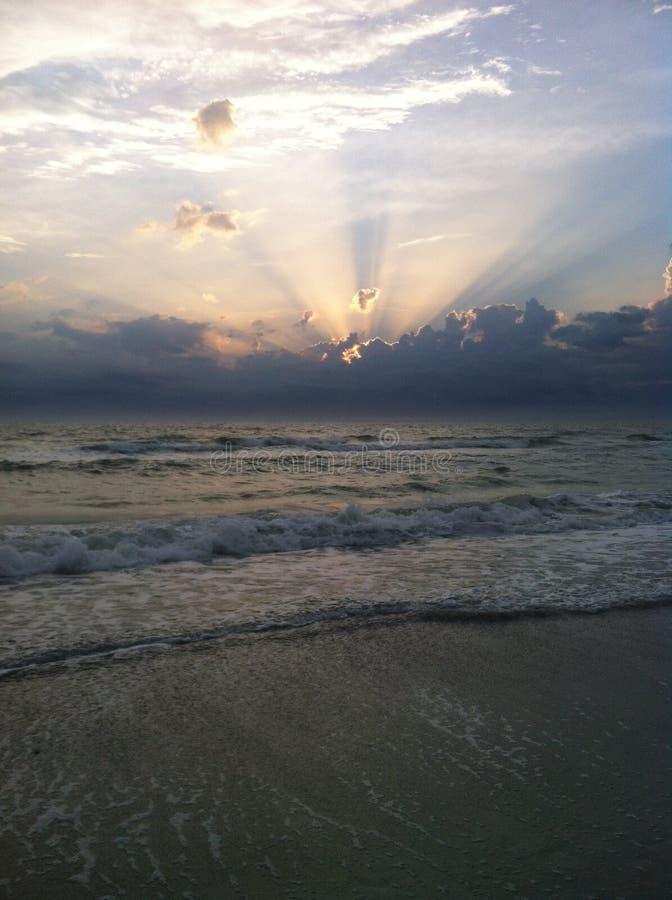 SoluppgångLido strand arkivbild