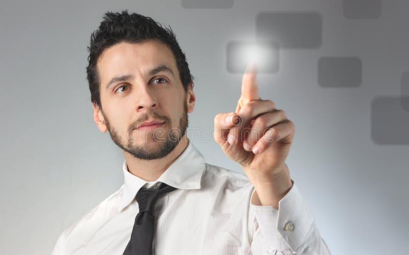 Solution. Business man pressing a touchscreen button