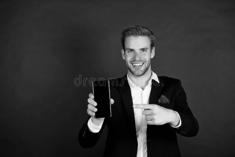Solution for business. Download new version. Software update. Guy bearded smartphone user. Guy shows smartphone screen. Copy space. Man satisfied try stock image