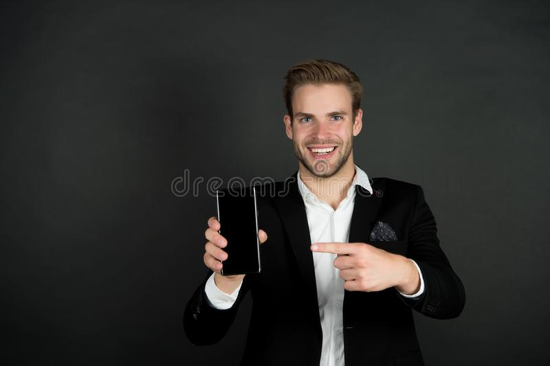 Solution for business. Download new version. Software update. Guy bearded smartphone user. Guy shows smartphone screen. Copy space. Man satisfied try royalty free stock images