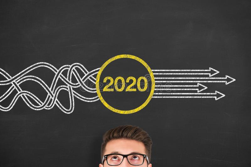 Solution Concepts New Year 2020 over Human Head on Blackboard Background stock photo