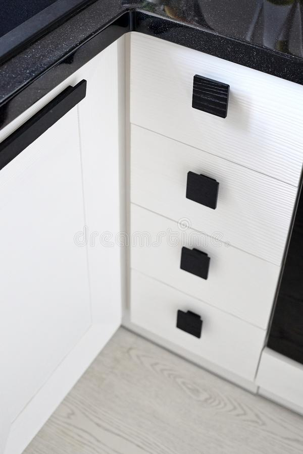 Solution for a kitchen corner storage in a cupboard. A corner un royalty free stock image