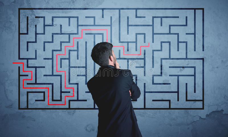 Solution of a maze stock images