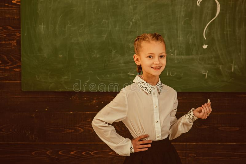 Solution. problem solution at school. smiling little girl wrote question mark as symbol of solution. girl has problem stock photo