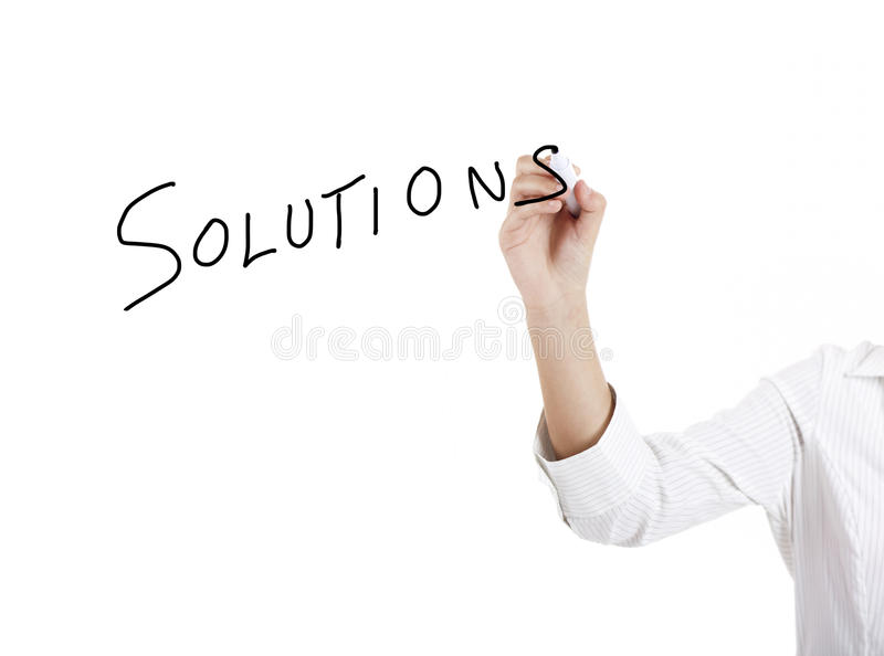 Solutions. Young businesswoman woman drawing the word solution stock photos