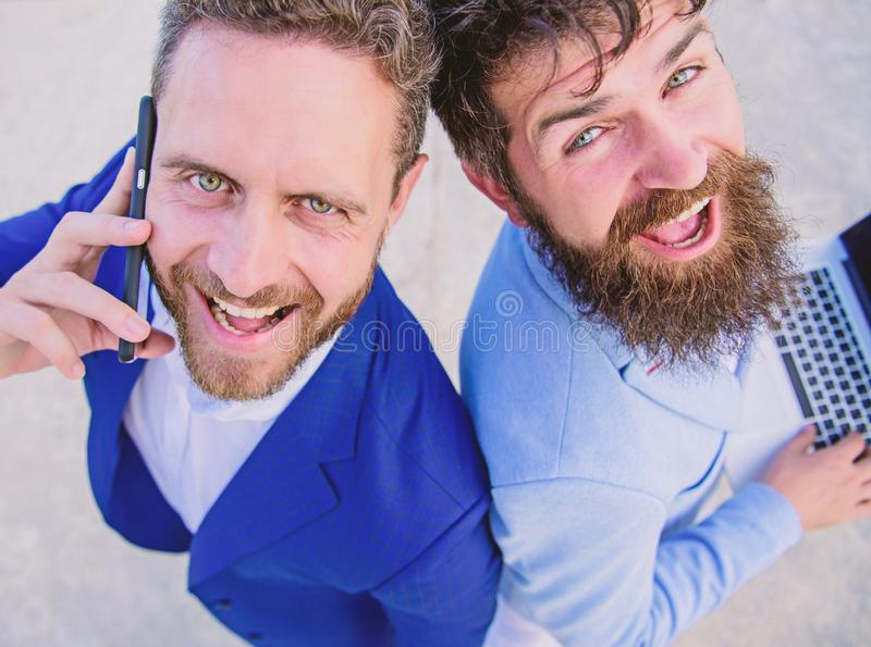 Solve problems immediately. Business people lawyers smiling faces. Partners team men stand back to back. Business. Experts online support close up. Business royalty free stock images