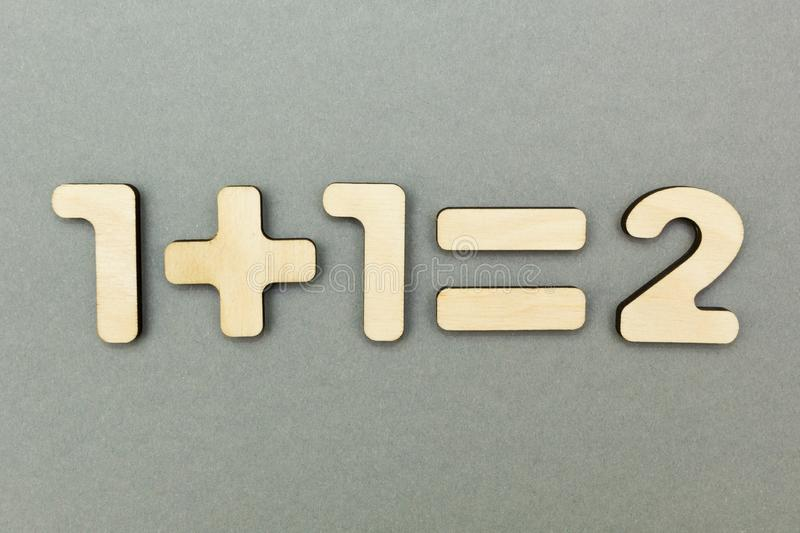 The solved example from wooden figures: one plus one is equal to two royalty free stock photography