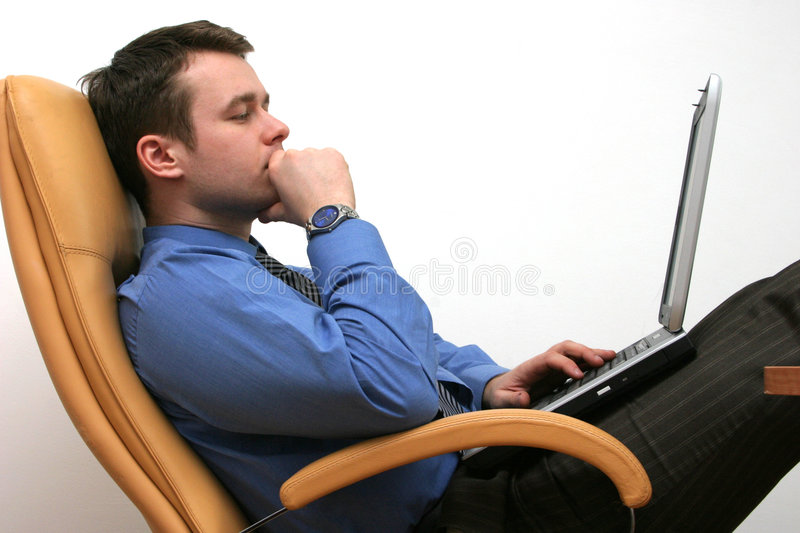 Solvig the problem. IT specialist is solving problem on his laptop stock photos