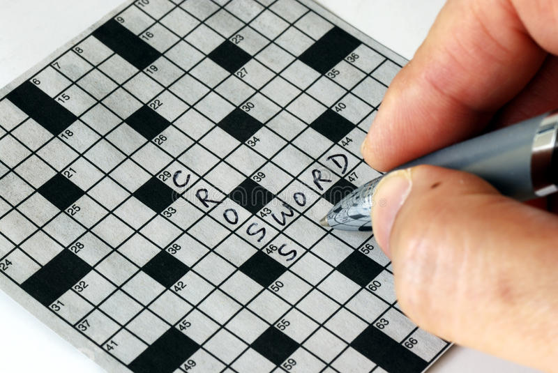 Download Solving The Cross Word Puzzle Stock Image - Image: 11729379