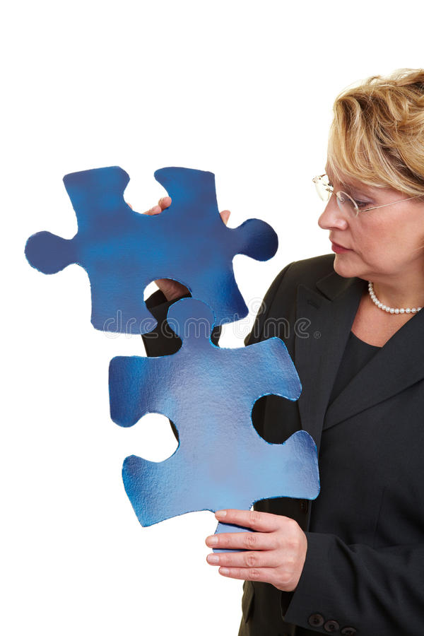 Solving a jigsaw puzzle royalty free stock photography