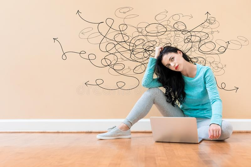 Solving a problem concept with woman using a laptop stock photography