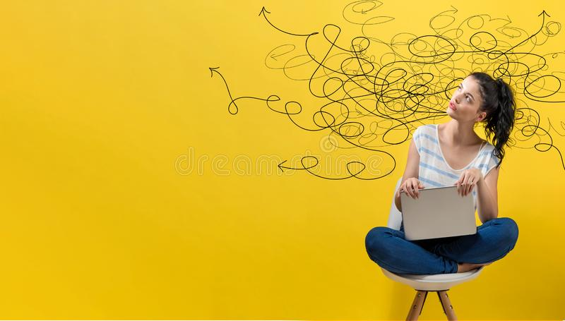 Solving a problem concept with woman using a laptop. Solving a problem concept with young woman using a laptop computer stock images