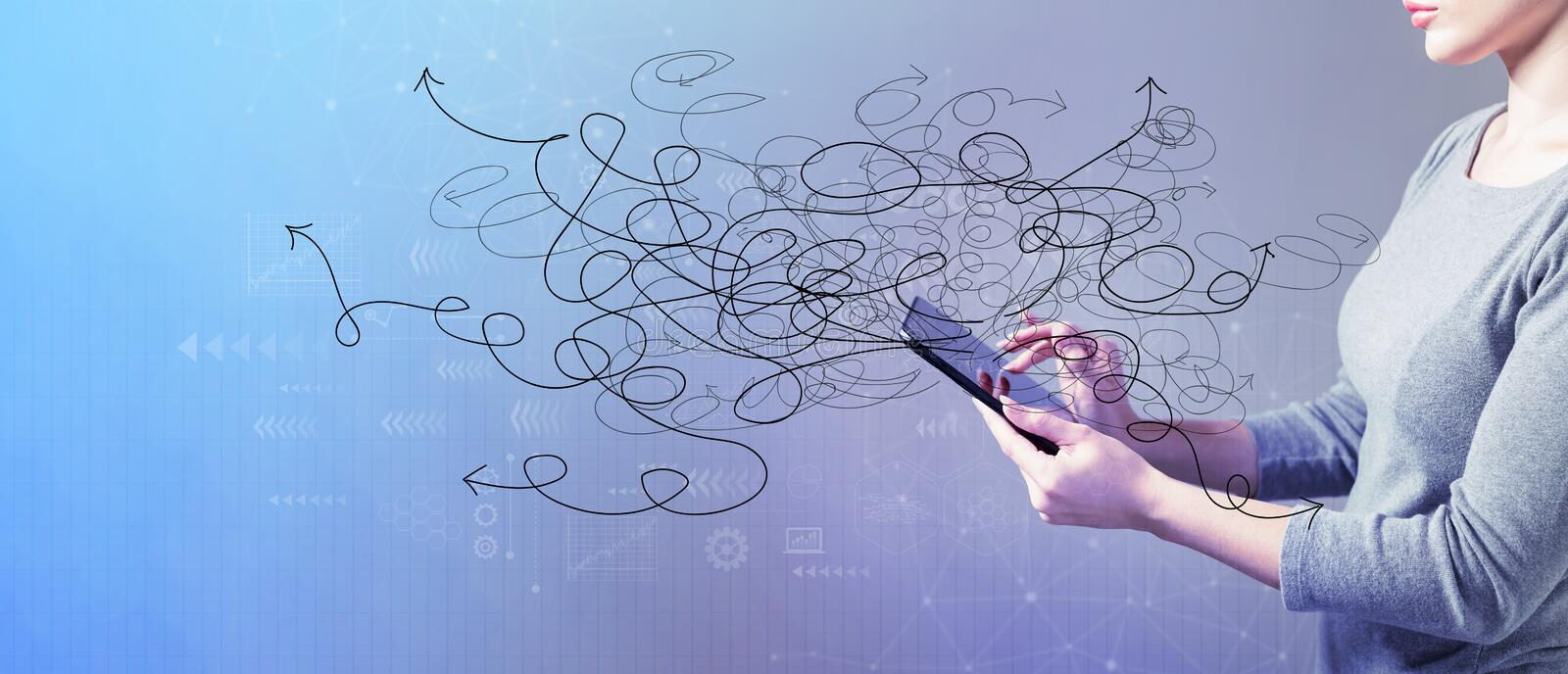 Solving a problem concept with woman using a tablet stock photo