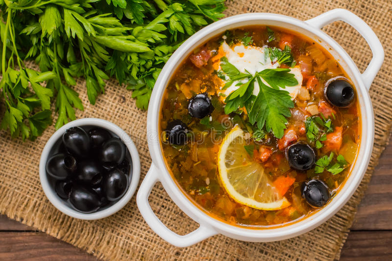 Solyanka, Russian dishes, soup on a steep meat broth with hot spices. Wooden background. Top view royalty free stock images