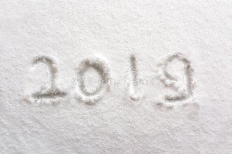 2019 som är skriftlig i snön, semestrar bakgrund arkivfoton