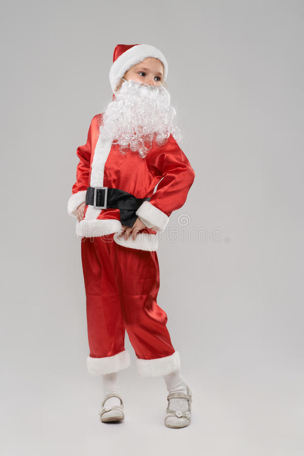 som barnet claus klädde santa arkivfoto