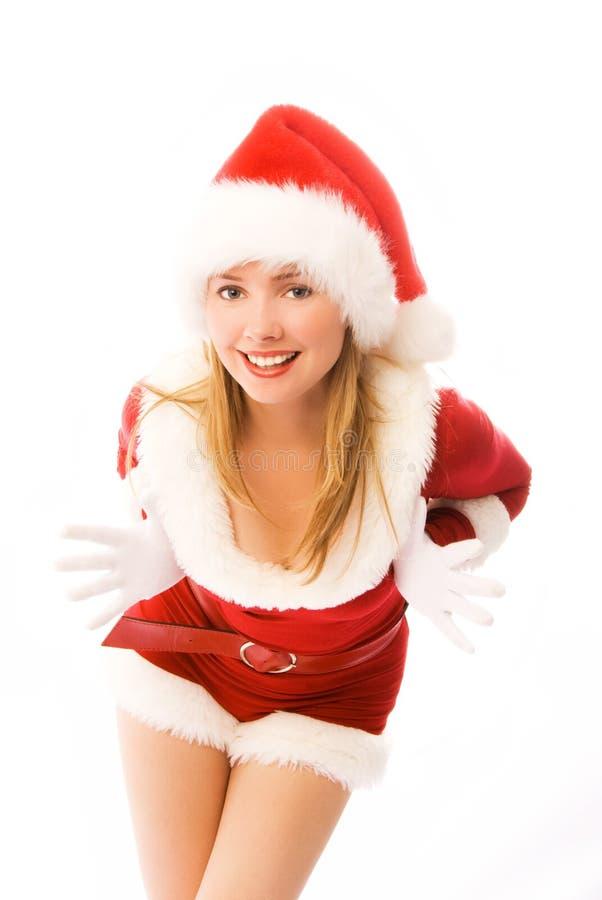 som den gladlynt klädda flickan santa royaltyfria bilder