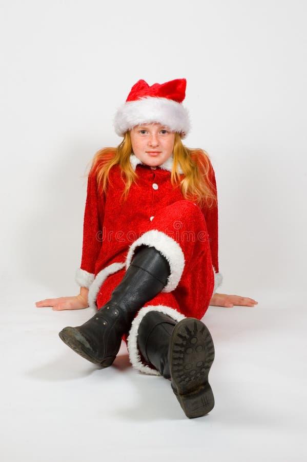 som den klädda flickan små santa royaltyfria foton
