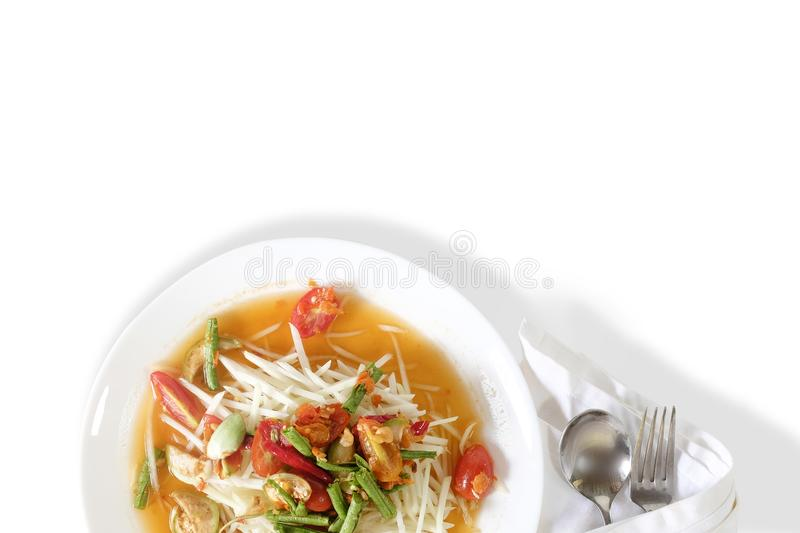 Som tam thai, green papaya salad on white table with space. stock photography