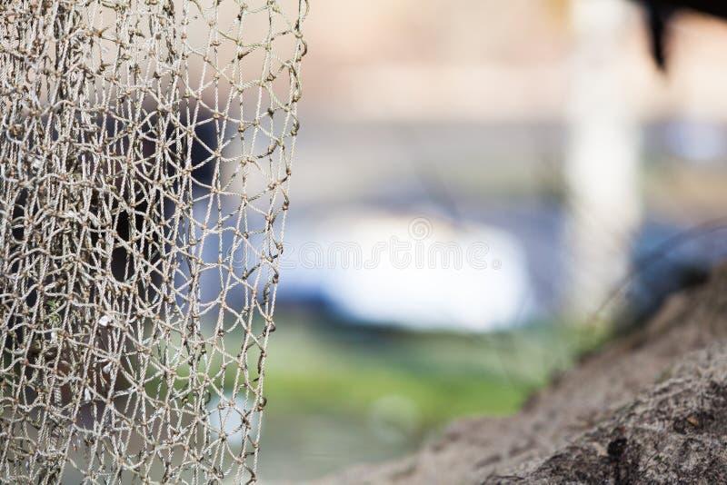 som vishet för utrustningfiskefolk Closeupen av det vita fisknätet förtjänar utomhus- royaltyfri fotografi
