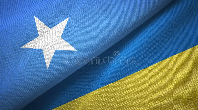 Somalia- und Ukraine-zwei Flaggentextilstoff, Gewebebeschaffenheit stockfotografie