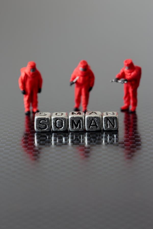 Soman em grânulos com uma equipe modelo diminuta do chemicall imagem de stock royalty free