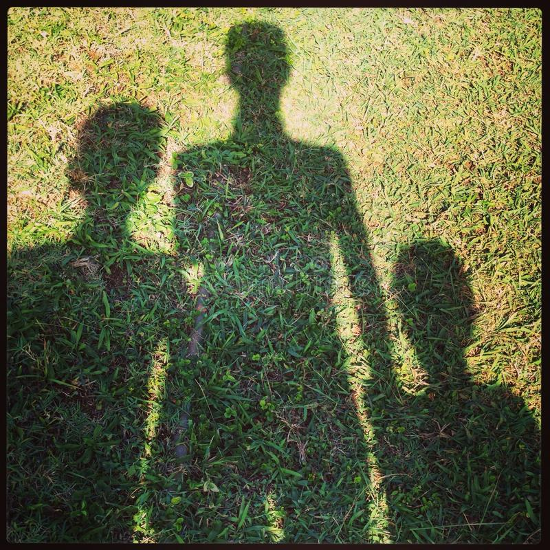 Sombra da família imagens de stock