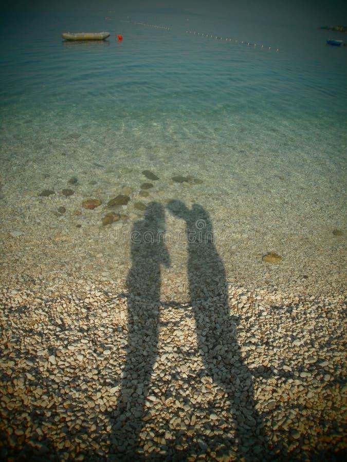 Sombra de la mujer y del hombre imagen de archivo