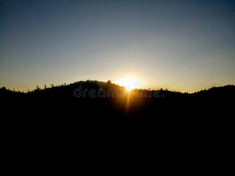 Sombra de la puesta del sol imagenes de archivo