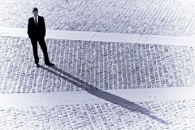 Sombra del hombre de negocios imagenes de archivo