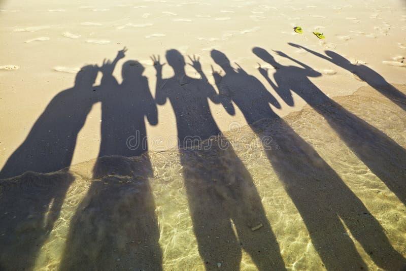 Sombra en la playa fotografía de archivo