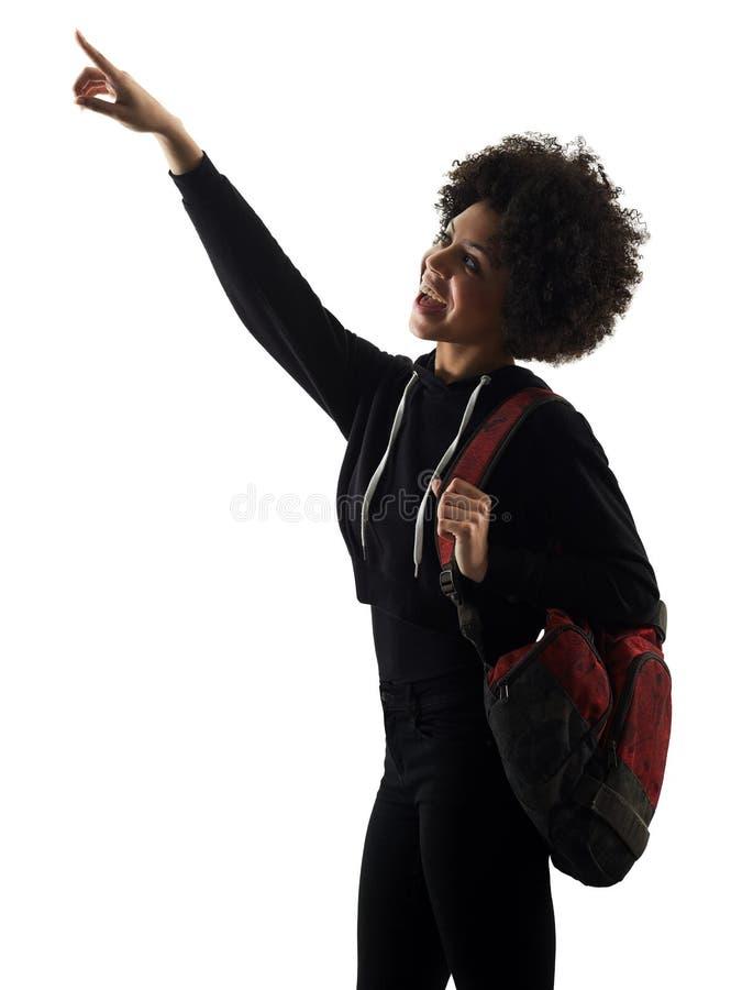 Sombra nova da mulher da menina do adolescente que olha acima apontando a silhueta imagem de stock