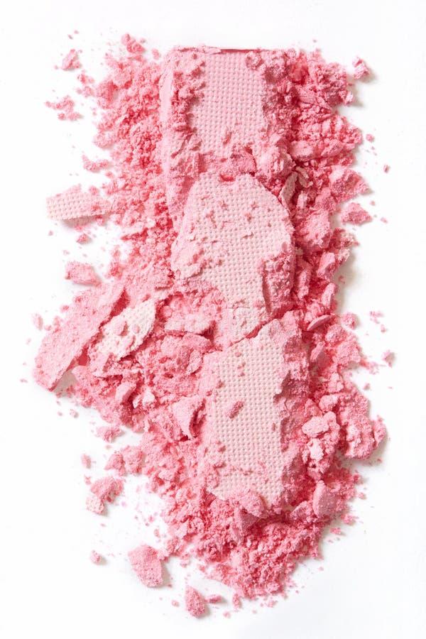 A sombra para os olhos cor-de-rosa compõe esmagado no branco foto de stock