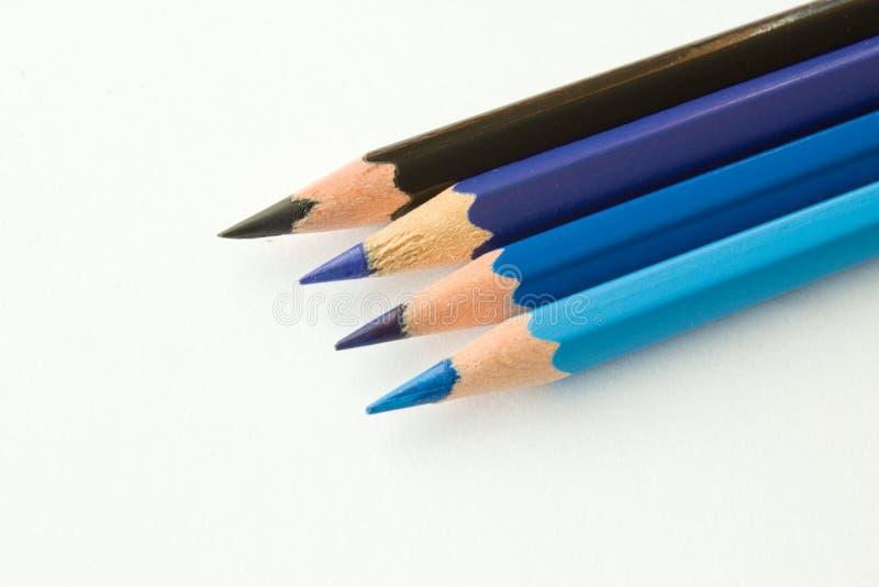 Sombras de creyones azules fotografía de archivo libre de regalías