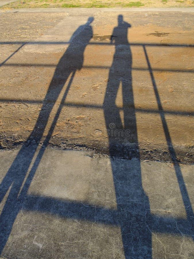 Download Sombras de dos personas foto de archivo. Imagen de caliente - 42446458