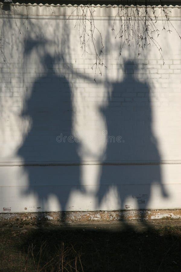 Sombras de jinetes imagenes de archivo