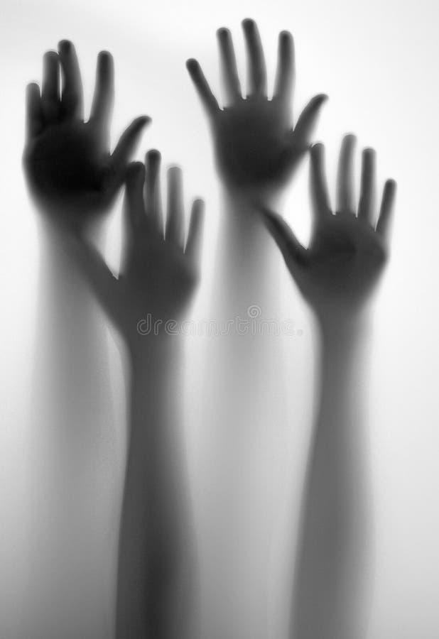 Sombras do mãos imagem de stock