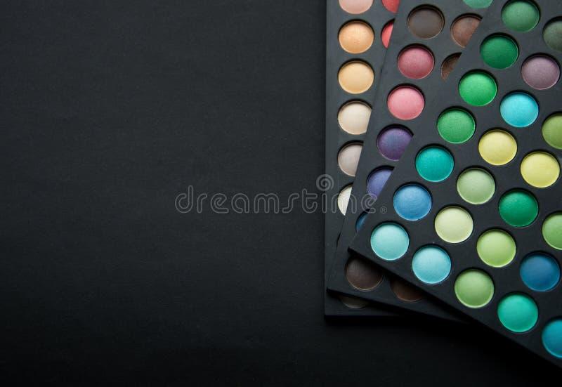Sombras para os olhos de cores diferentes imagens de stock