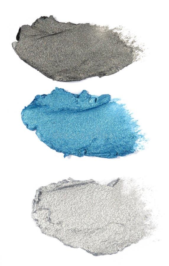 Sombreador de ojos poner crema azul y gris aislado en blanco imagen de archivo