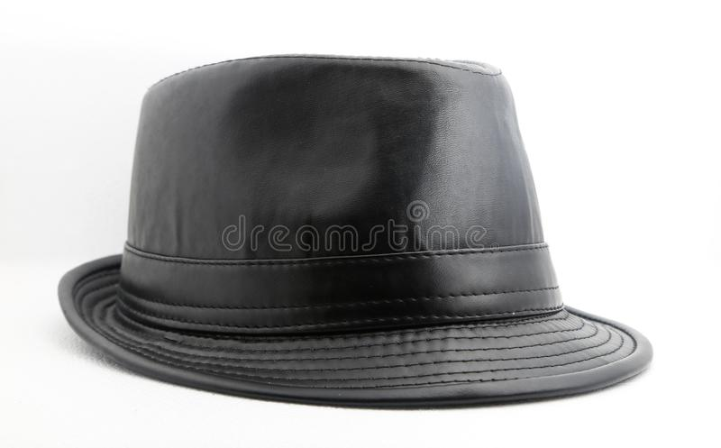 Sombrero de cuero negro sobre el fondo blanco imagen de archivo libre de regalías